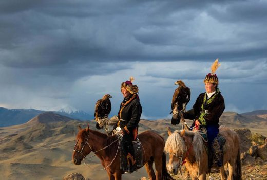 Eagle hunter and model father Nurgaiv with his eagle huntress doughter Aisholpan